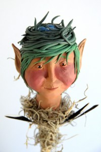 This is a Bloomingstacker made out of polymer clay and painted with arcylic