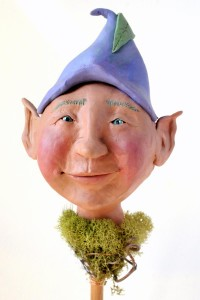 This is a polymer clay Bloomingstacker. He is for decorating plant pots.